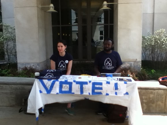 Mael and Kwame encouraging grad students to vote outside the library