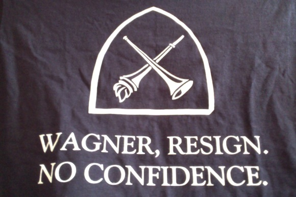 "T-shirt with inverted Emory crest: ""Wagner, resign. No confidence"""